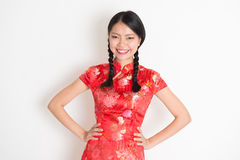 Asian chinese girl in qipao Royalty Free Stock Photos