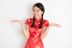 Asian chinese girl showing palm Stock Photos