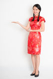 Asian chinese girl showing something Stock Photography