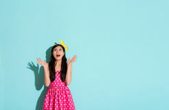 Girl with happy gestures looking at the copyspace Royalty Free Stock Image