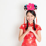 Asian chinese girl wishing Stock Photo