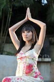Asian Chinese Girl in Yoga pose Stock Image