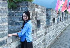 Asian Chinese girls wear student clothes in Republic of China. In an ancient town, stand by an old stone wall, pretty beautiful girl, classic student clothes royalty free stock photos