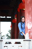Asian Chinese girls wear student clothes in Republic of China. In an ancient town, stand by an old stone wall, pretty beautiful girl, classic student clothes stock images