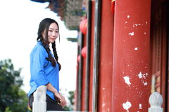 Asian Chinese girls wear student clothes in Republic of China. In an ancient town, stand by an old stone wall, pretty beautiful girl, classic student clothes royalty free stock image