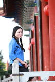 Asian Chinese girls wear student clothes in Republic of China. In an ancient town, stand by an old stone wall, pretty beautiful girl, classic student clothes stock image