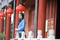 Asian Chinese girls wear student clothes in Republic of China. In an ancient town, stand by an old stone wall, pretty beautiful girl, classic student clothes royalty free stock images