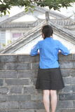 Asian Chinese girls wear student clothes in Republic of China. In an ancient town, stand by an old stone wall, pretty beautiful girl, classic student clothes stock photo