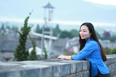 Asian Chinese girls wear student clothes in Republic of China. In an ancient town, stand by an old stone wall, pretty beautiful girl, classic student clothes stock photography
