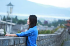 Asian Chinese girls wear student clothes in Republic of China. In an ancient town, stand by an old stone wall, pretty beautiful girl, classic student clothes stock photos