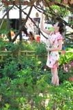 Asian Chinese girls wears cheongsam enjoy free time in ancient town. Asian Chinese girls wear cheongsam, in an ancient town, traditional cloth, made of silk stock photography