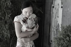 Asian Chinese girls wears cheongsam enjoy free time in ancient town Royalty Free Stock Photography