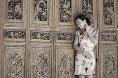 Asian Chinese girls wears cheongsam enjoy free time in ancient town Royalty Free Stock Image