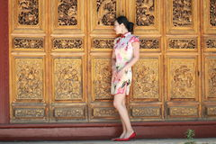 Asian Chinese girls wears cheongsam enjoy free time in ancient town Stock Photography