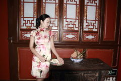 Asian Chinese girls wears cheongsam enjoy free time in ancient town royalty free stock images