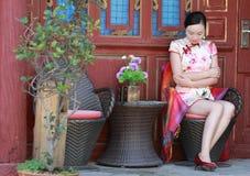 Asian Chinese girls wears cheongsam enjoy holiday in ancient town. Asian Chinese girls wear cheongsam, in an ancient town, traditional cloth, made of silk stock photography