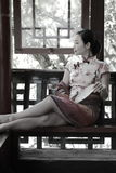 Asian Chinese girls wears cheongsam enjoy holiday in lijiang ancient town. Asian Chinese girls wear cheongsam, in an ancient town, traditional cloth, made of royalty free stock photography