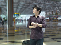 Asian Chinese guy waiting at the airport Royalty Free Stock Photos