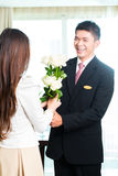Asian Chinese hotel manager welcoming VIP guest royalty free stock photography