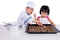 Asian Chinese Kid Baking Cookies Stock Image