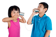 Asian Chinese Kid Playing with Tin Can Phone Royalty Free Stock Photography
