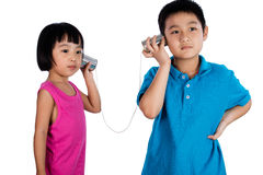 Asian Chinese Kid Playing with Tin Can Phone Royalty Free Stock Images