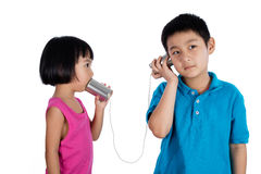 Asian Chinese Kid Playing with Tin Can Phone Stock Image