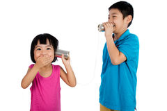 Asian Chinese Kid Playing with Tin Can Phone Royalty Free Stock Image
