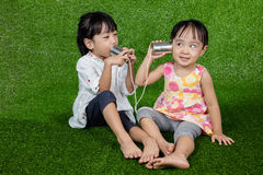 Asian Chinese Kids Playing with Tin Can Phone Royalty Free Stock Photography