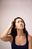 Asian chinese lady feeling puzzled Stock Photos