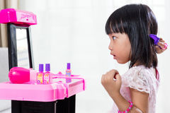 Asian Chinese Liitle Girl Playing With Make-Up Toys Stock Image