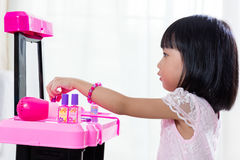 Asian Chinese Liitle Girl Playing With Make-Up Toys Stock Images