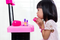 Asian Chinese Liitle Girl Playing With Make-Up Toys Royalty Free Stock Image