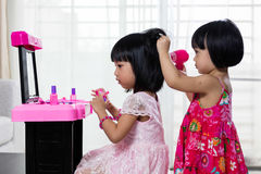 Asian Chinese Liitle Sisters Playing With Make-Up Toys Stock Images
