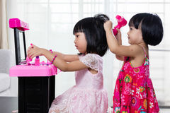 Asian Chinese Liitle Sisters Playing With Make-Up Toys Royalty Free Stock Image