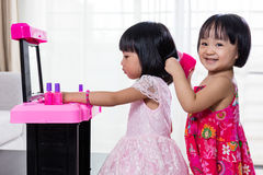 Asian Chinese Liitle Sisters Playing With Make-Up Toys Royalty Free Stock Photos