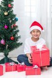 Asian Chinese little boy holding Christmas gift box Royalty Free Stock Image