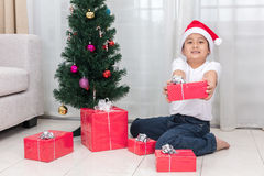 Asian Chinese little boy holding Christmas gift box Stock Photography