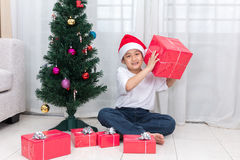 Asian Chinese little boy holding Christmas gift box Stock Images
