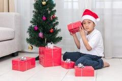 Asian Chinese little boy holding Christmas gift box Royalty Free Stock Photo