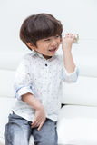 Asian Chinese little boy playing retro tin can phone Stock Photo