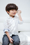 Asian Chinese little boy playing retro tin can phone Stock Photos