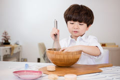 Asian Chinese little boy prepare for baking cookies Stock Photo