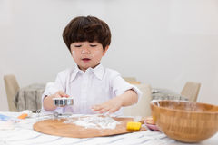 Asian Chinese little boy prepare for baking cookies Stock Image