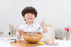 Asian Chinese little boy prepare for baking cookies Royalty Free Stock Photo