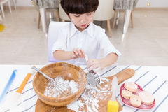 Asian Chinese little boy prepare for baking cookies Royalty Free Stock Photos