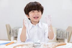 Asian Chinese little boy prepare for baking cookies Royalty Free Stock Images