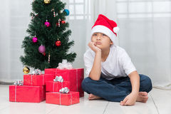 Asian Chinese little boy showing bored expression with Christmas Stock Photos