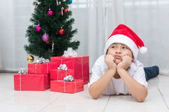 Asian Chinese little boy showing bored expression with Christmas Royalty Free Stock Image