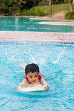 Asian Chinese Little Boy Swimming With Floating Board. At Outdoor Swimming Pool stock photos